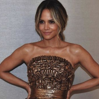 52-year-old Halle Berry showed a full back tattoo