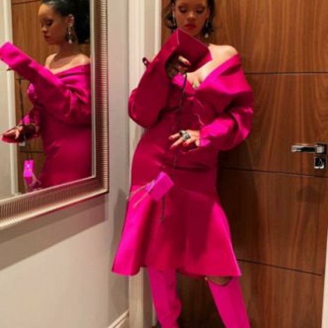 Rihanna tried on a bright dress from her debut luxury collection
