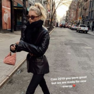 Elsa Hosk walks in Brooklyn in a black leather jacket