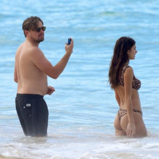 Leonardo DiCaprio took a young girlfriend to an exotic island