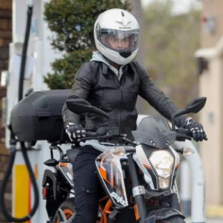Halle Berry chases Malibu on a motorcycle