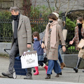 Milla Jovovich with her husband and daughters on a walk-in Vancouver