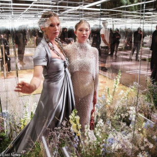 Kate Moss on the catwalk with daughter Leela