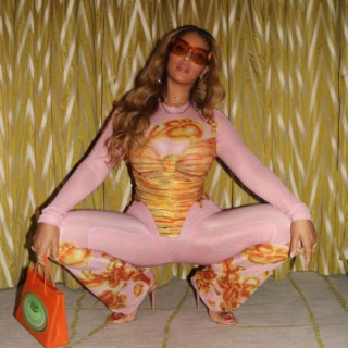 Beyonce posed in a pink outfit