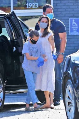 Angelina Jolie in a protective mask went shopping with her daughter